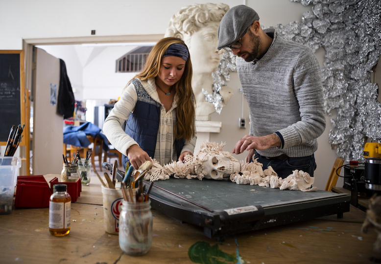 Alexandra Edwards, C'19, a fine arts major at Mount St. Mary's University, works on an art project